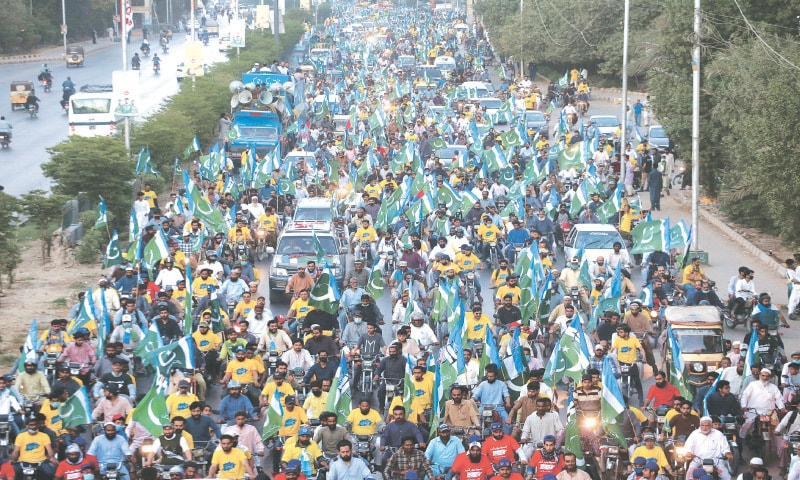 THE JI rally passes through Sharea Faisal on Sunday.—Photo by Shakil Adil/White Star