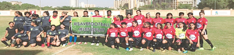 KARACHI: Players of Karachi United and a combined Pakistan Army/Wapda XI pose before their friendly match on Sunday.