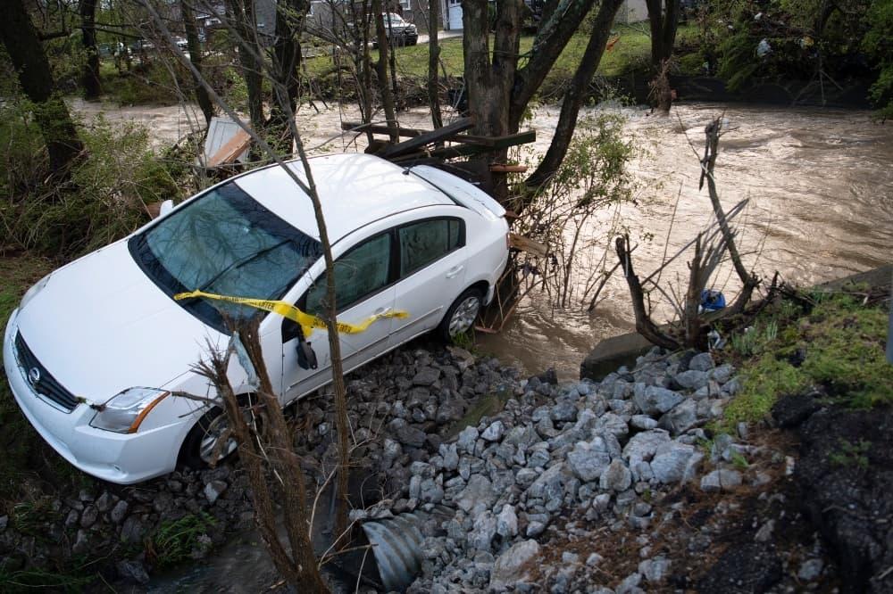 A car rests in a ravine along Blackman Dr. near Edmondson Pike on March 28. — AP