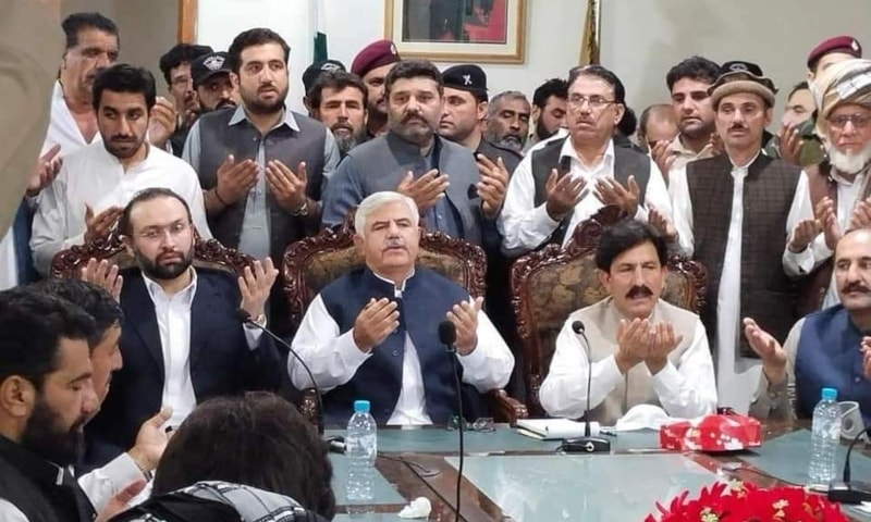 Khyber Pakhtunkhwa Chief Minister Mehmood Khan prays with other members of the negotiations upon a successful settlement. — Photo provided by Sirajuddin