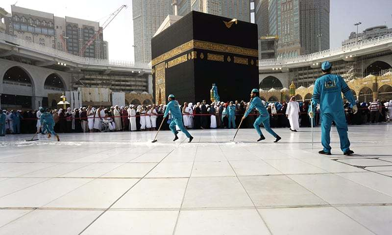 In this file photo, workers sterilise the ground in front of the Kaaba at the Grand Mosque in Makkah, Saudi Arabia. — AP
