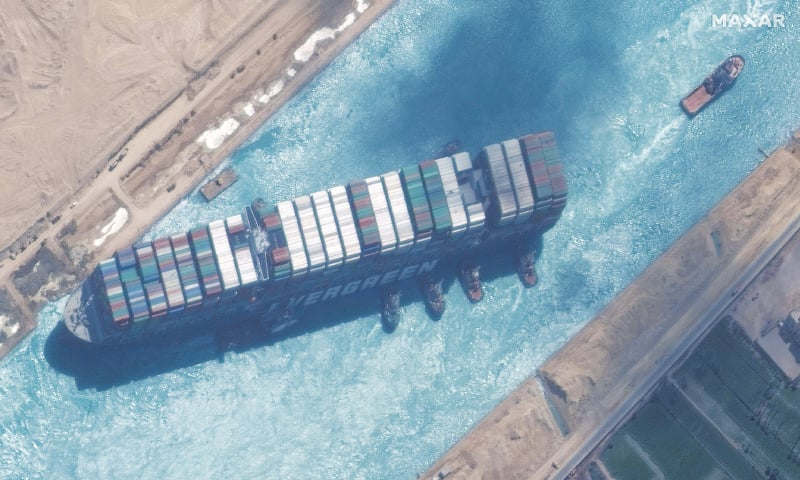 THIS satellite image released by Maxar Technologies shows a close-up overview of the container ship blocking the Suez Canal and tugboats engaged in efforts to refloat it. The MV Ever Given was at last refloated and the canal reopened on Monday, sparking relief almost a week after the huge container ship got stuck during a sandstorm and blocked a major artery for global trade.—AFP