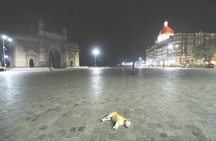 A view of the Gateway of India monument and the Taj Hotel in Mumbai during a curfew on Monday to limit the spread of Covid-19.—Reuters