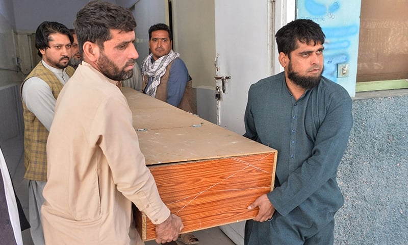 Relatives transport the body of a female polio worker who was shot dead by gunmen, in Jalalabad on March 30. — AFP