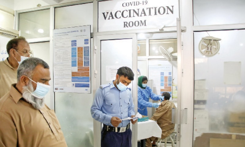 A man receives Covid-19 vaccine shot at CDA Hospital in Islamabad as vaccination of citizens aged 50 and above started on Tuesday. — Photo by Mohammad Asim