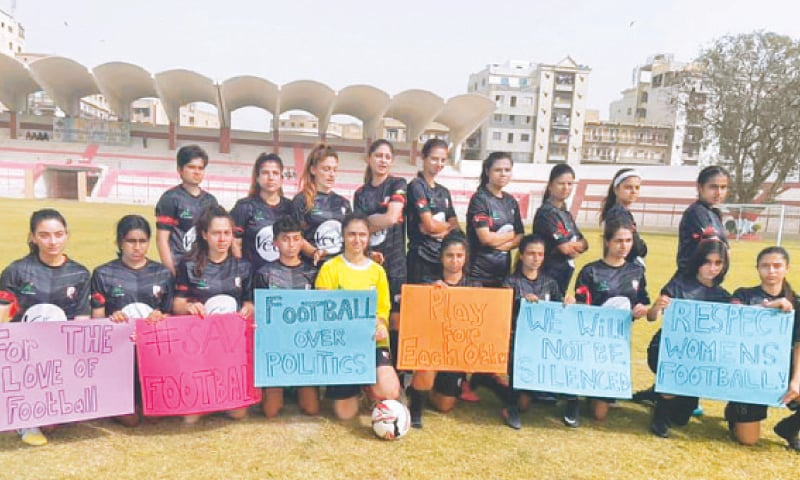 KARACHI United players stage a protest ahead of their National Women's Football Championship match against Pakistan Army at the KPT Stadium on Tuesday.—courtesy Karachi United