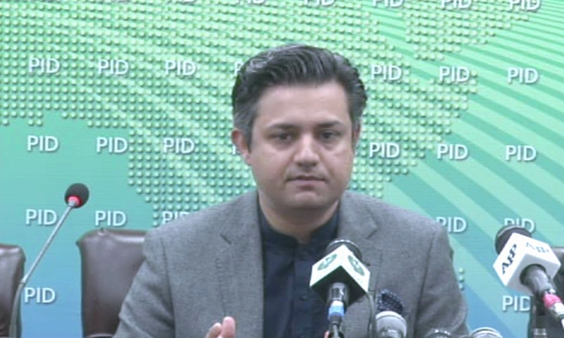 In this file photo, Minister for Industries Hammad Azhar, who has also been given the additional portfolio of finance minister, addresses a press conference in Islamabad. — DawnNewsTV/File