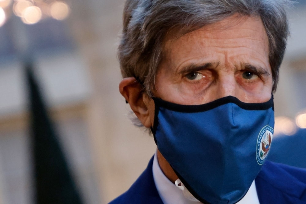 In this photo taken on March 10, US Special Presidential Envoy for Climate John Kerry speaks to the press as he leaves after a meeting with the French president at The Elysee Presidential Palace in Paris.