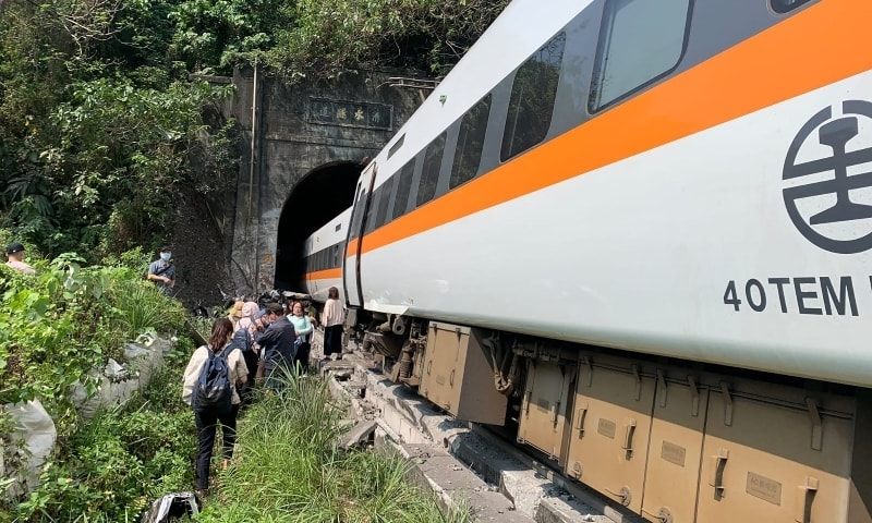 This handout picture taken and released on April 2 by Taiwan's Central Emergency Operation Center shows the scene of where a train derailed inside a tunnel in the mountains of Hualien. — AFP