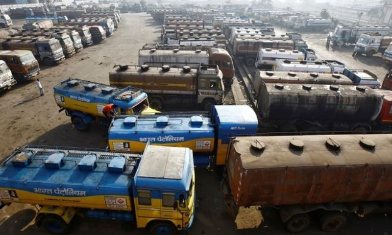 Oil tankers are seen parked at a yard outside a fuel depot on the outskirts of Kolkata, India. — Reuters/File