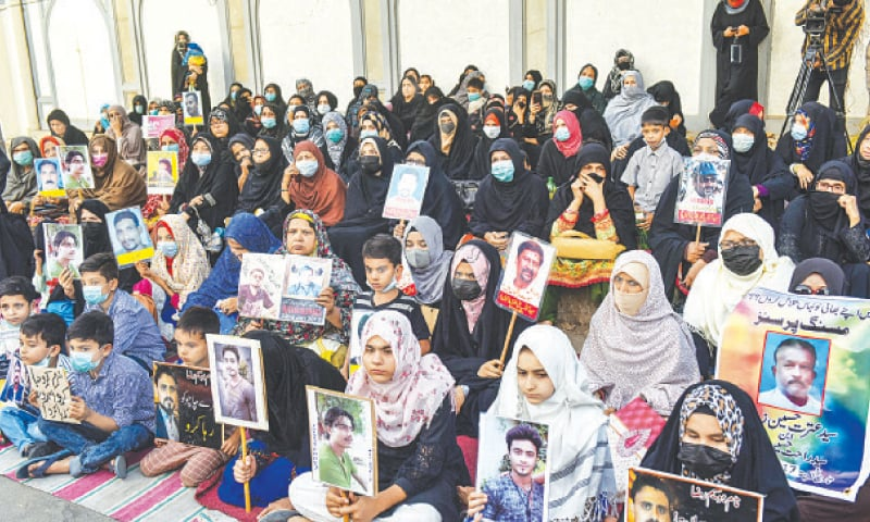 Family members of missing persons protest outside the Mehfil Shah-i-Khorasan mosque on Friday.—Fahim Siddiqi/White Star