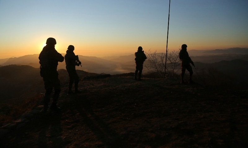 In this Dec 18, 2020 photo, Indian army soldiers patrol along the Line of Control n Poonch. — AP