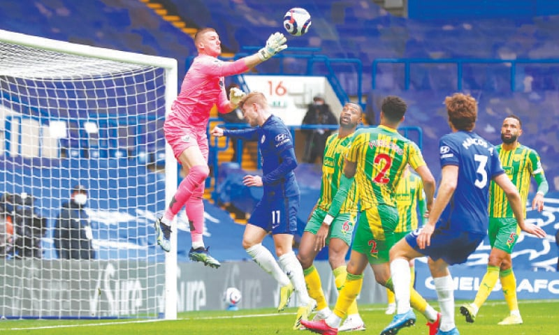 LONDON: West Bromwich Albion goalkeeper Sam Johnston makes a save during the English Premier League match against Chelsea at Stamford Bridge on Saturday.—AP