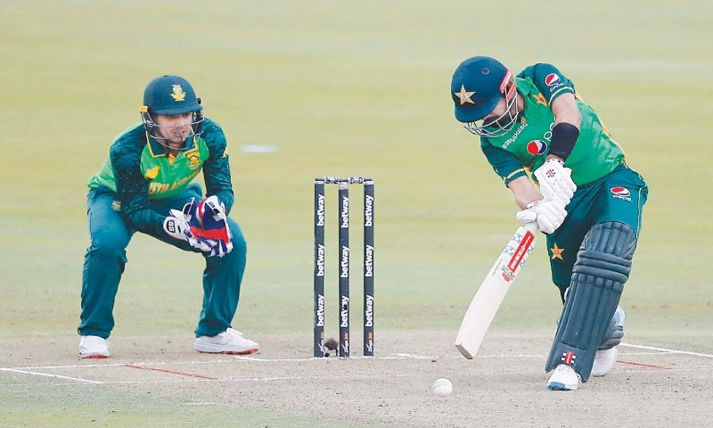 Pakistan captain Babar Azam drives during his innings of 103 as South African wicket-keeper Quinton de Kock looks on during the first One-day International at the SuperSport on Friday. — AFP/File