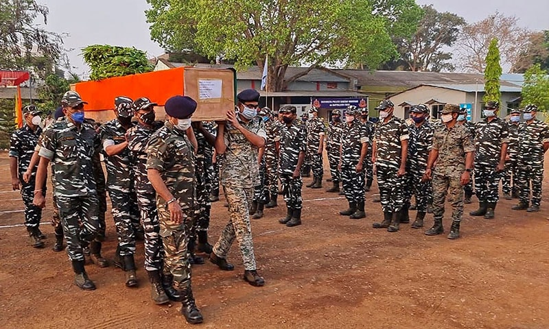Members of Indian security forces carry the coffin of one of their colleague, who died following a gun battle with Maoist rebels that left 22 members of Indian security forces killed and 30 others wounded, at the Central Reserve Police Force's Jagdalpur camp in Bijapur district of India's Chhattisgarh state on April 4, 2021. — AFP