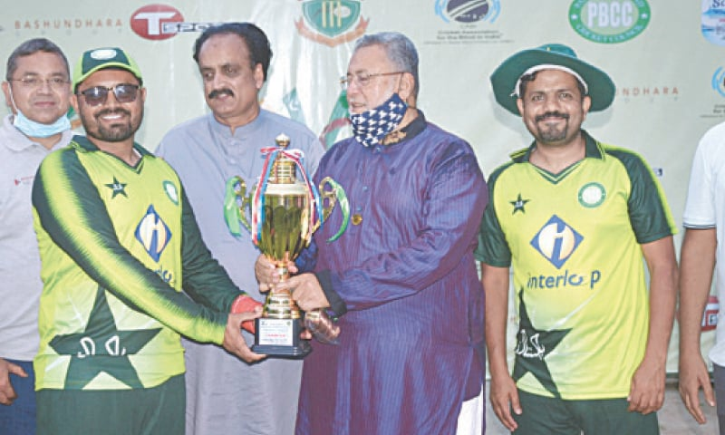 DHAKA: Pakistan Blind Cricket team's captain Nisar Ali receives the winning trophy from chief guest Dildar Alam Chodhri, Vice Chairman Bangladesh Blind Cricket Council here on Sunday. Syed Sultan Shah, President World Blind Cricket Council, is also seen in the picture.