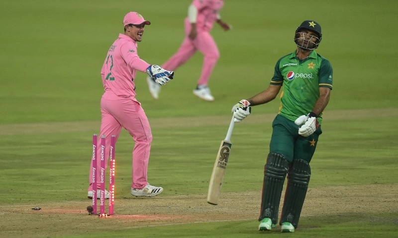 Fakhar Zaman (R) reacts after being run out by South Africa's Aiden Markram (not visible) as South African wicketkeeper Quinton de Kock (L) looks on during the second ODI between South Africa and Pakistan at Wanderers Stadium in Johannesburg on April 4. — AFP