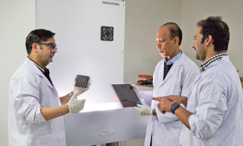 Dr Najeebullah discusses the project with his colleagues at a laboratory of the UET, Peshawar. — White Star