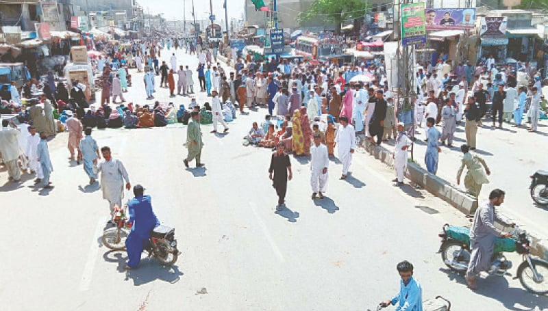 HUB: Members of the All Balochistan Employees and Workers Grand Alliance block RCD Highway on Monday as they hold a demonstration for acceptance of their demands.—PPI