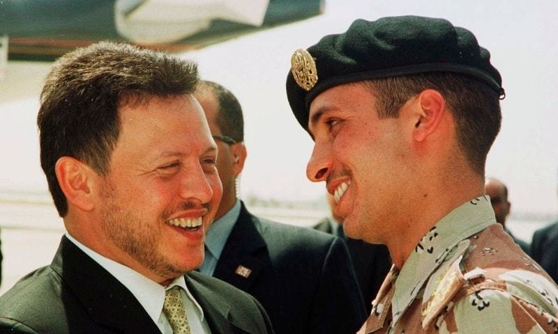 In this file photo, Jordan's King Abdullah II laughs with his half brother Prince Hamzah, right, shortly before the monarch embarked on a tour of the United States. — AP