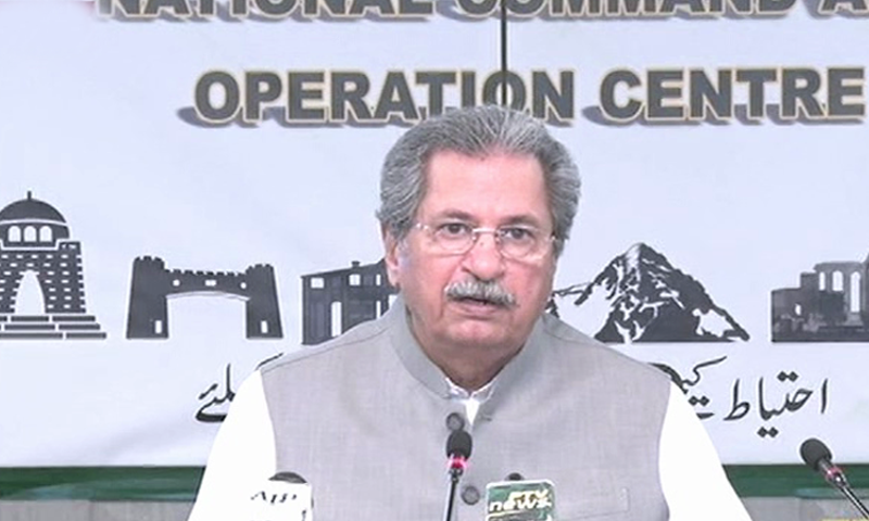 Minister for Education and Professional Training Shafqat Mahmood addresses the media on Tuesday. — DawnNewsTV