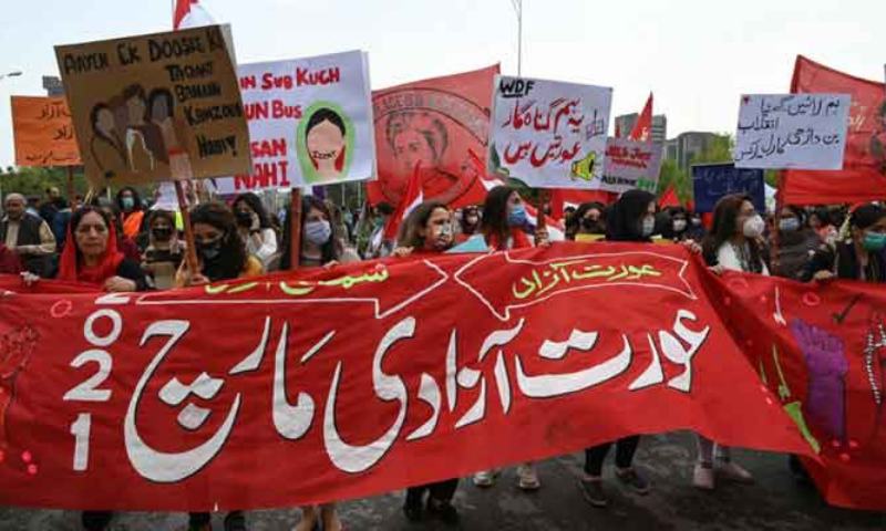 Activists of the Aurat March carry placards as they march during a rally to mark International Women's Day in Islamabad on March 8. — AFP/File