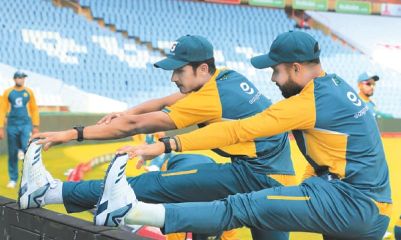 CENTURION: Pakistan fast bowler Mohammad Hasnain (L) and all-rounder Faheem Ashraf limber up during a training session at the SuperSport Park on Tuesday.—Courtesy PCB