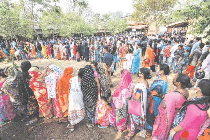 GUWAHATI: People queue up to cast their votes at a polling station in India's Assam state on Tuesday.—AFP