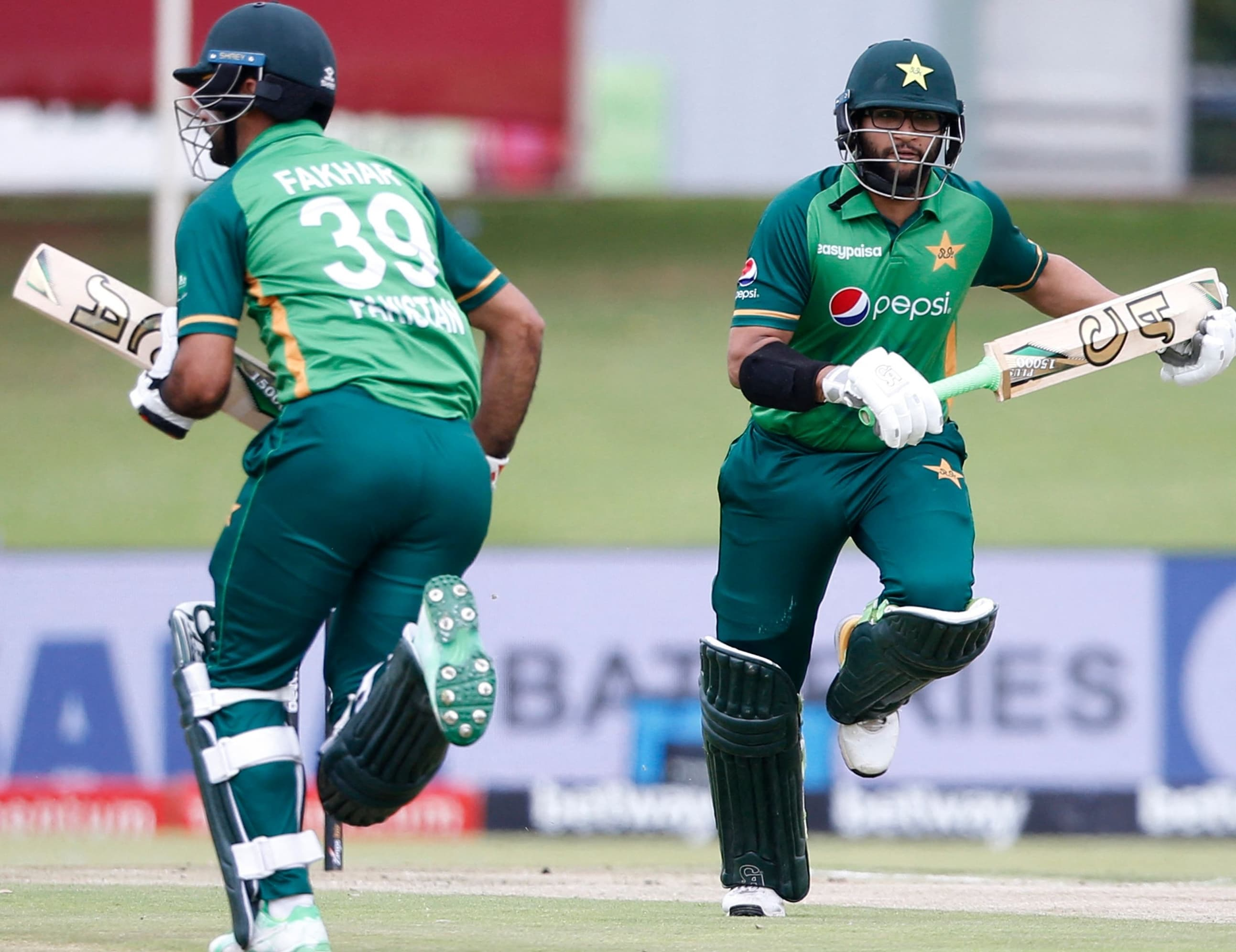 Imamul Haq (R) and Fakhar Zaman run between the wickets during the third ODI. — AFP