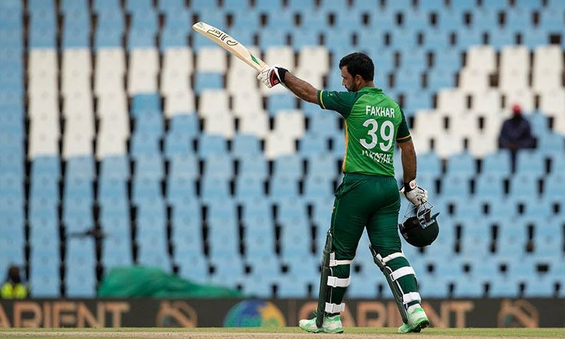Fakhar Zaman raises his bat after hitting his second successive century. — AFP