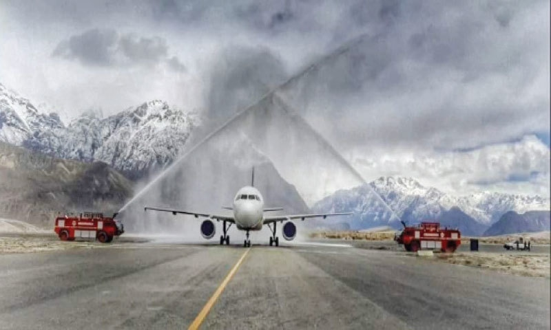 The PIA flight receives a water salute at Skardu Airport on Wednesday. — Dawn