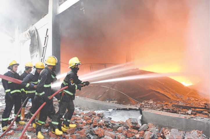 Firefighters trying to put out a fire at a Chinese-owned factory on Wednesday.—Reuters