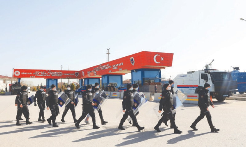 RIOT police enter the premises of the court where the trial was conducted.—AFP