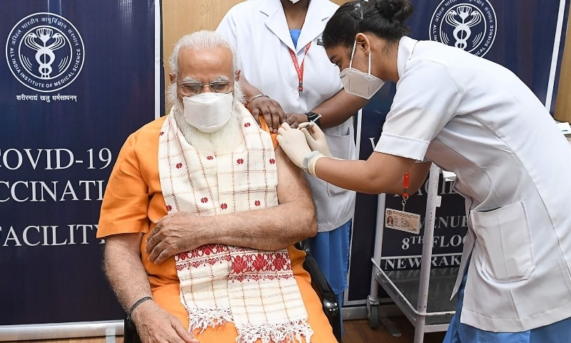 In this handout photograph taken on April 8, India's Prime Minister Narendra Modi (L) receives the second dose of the Covaxin Covid-19 coronavirus vaccine, at AIIMS hospital in New Delhi. — AFP