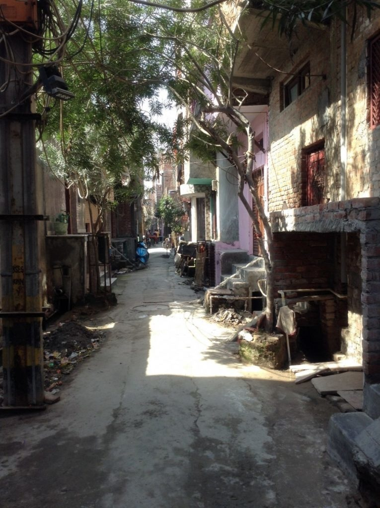 Muslim houses on both sides of the lane near Madina Masjid have been locked. Photo by author