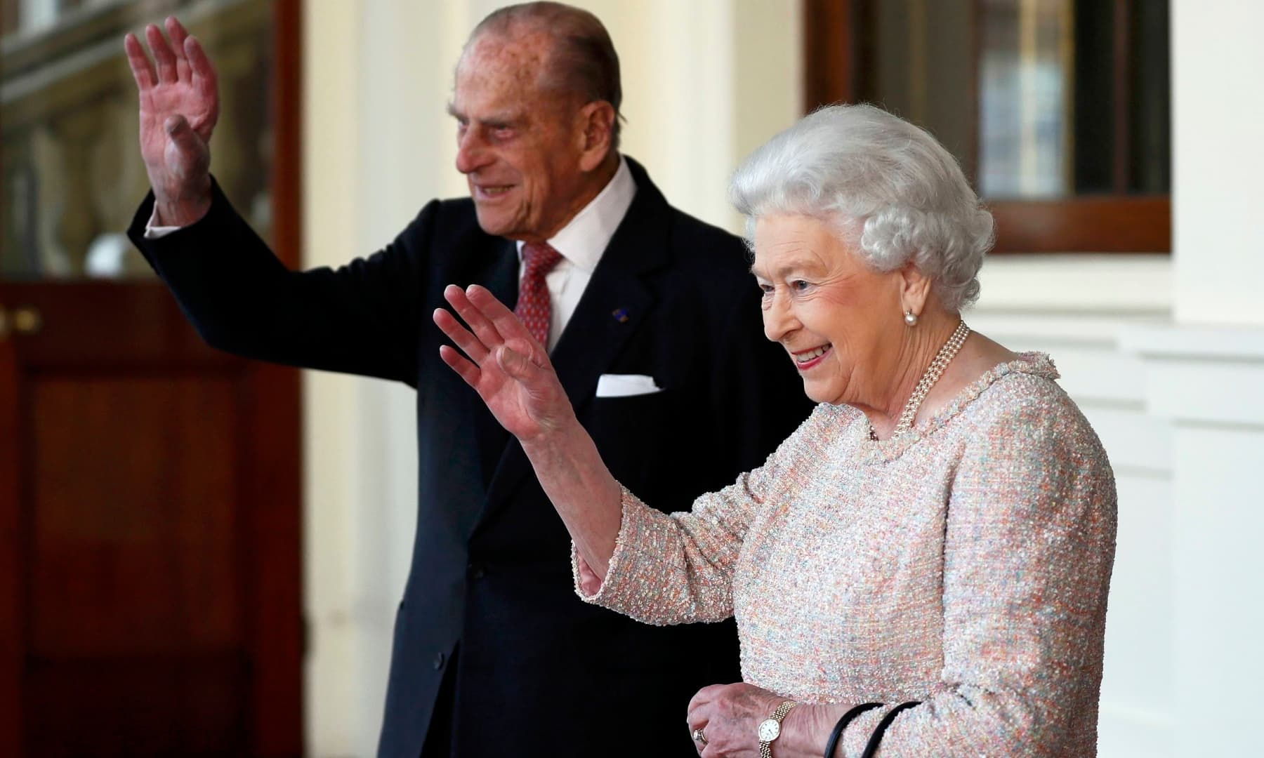 Britain's Queen Elizabeth and Prince Philip bid farewell to Colombia's President Juan Manuel Santos and his wife Maria Clemencia de Santos following their state visit, at Buckingham Palace in London, Britain. — Reuters/File