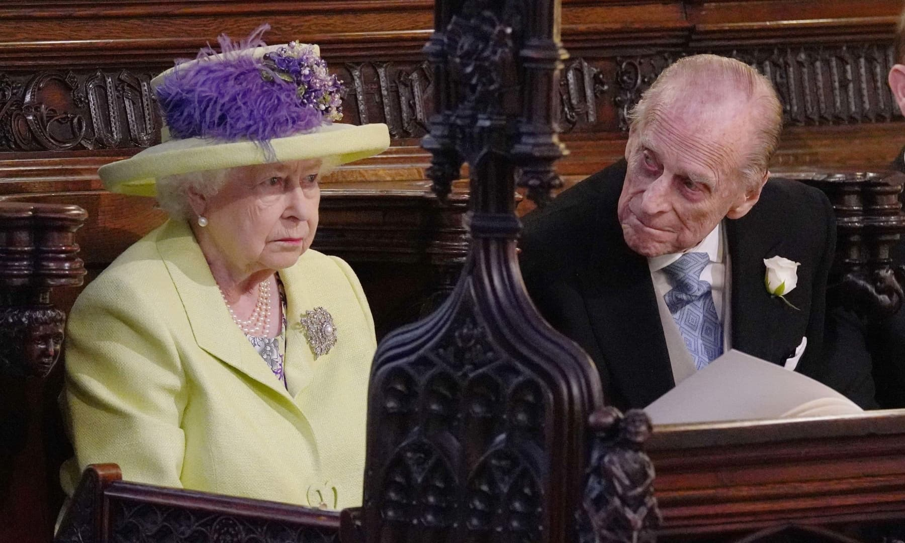 Queen Elizabeth and her husband Prince Philip at the wedding ceremony of Prince Harry and Meghan Markle. — AP/File