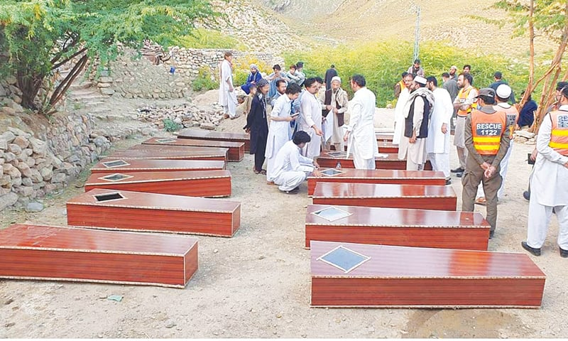Relatives and officials with coffins carrying remains of the coalminers in Darra Adam Khel.—Dawn