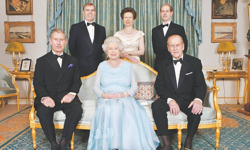 A FILE photo taken on Nov 18, 2007, shows Queen Elizabeth and Prince Philip (right foreground) during a dinner hosted by Prince Charles (left foreground) to mark the 60th wedding anniversary of the Queen and the Duke of Edinburgh. Those standing are Prince Andrew (left), Princes Anne (centre) and Prince Edward.—AFP