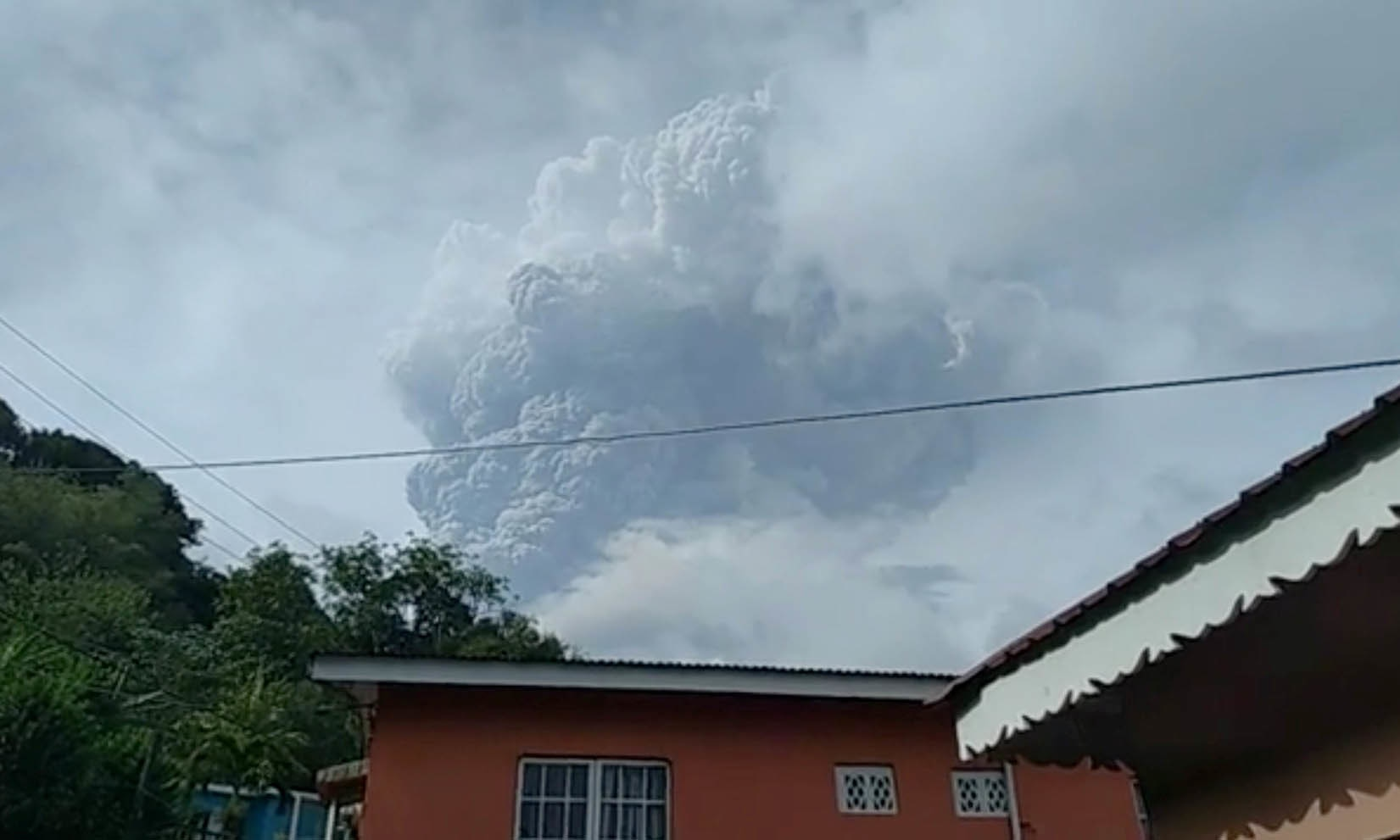 Ash plume is seen in the sky as La Soufriere volcano erupts on April 9. — Reuters