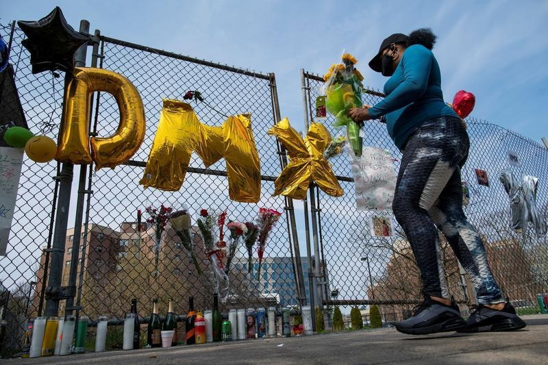 Fans light candles at a makeshift memorial for musician and actor DMX outside White Plains Hospital, New York. Photo: Reuters