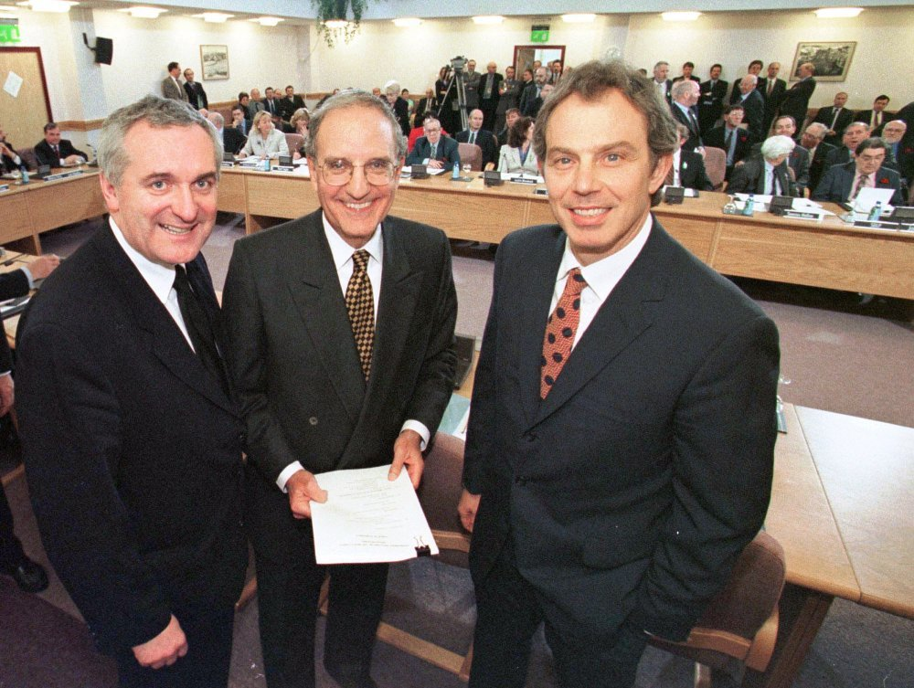 In this April 10, 1998, file photo, (from right) British Prime Minister Tony Blair, US Senator George Mitchell, and Irish Prime Minister Bertie Ahern, pose together after they signed the Good Friday Agreement for peace in Northern Ireland. — AP