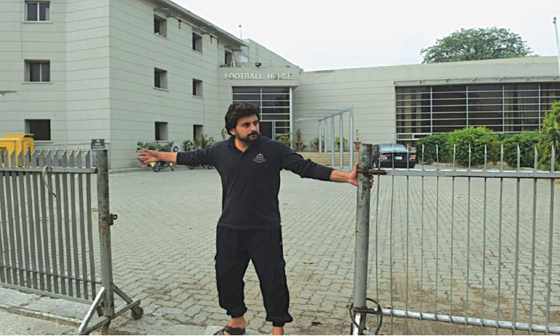 A guard closes the gates to Football House, the PFF headquarters in Lahore   APF