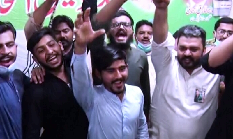 PML-N supporters celebrate the victory of party candidate Syeda Nosheen Iftikhar. — DawnNewsTV