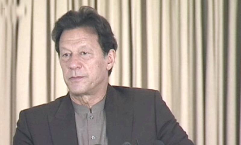 Prime Minister Imran Khan addresses a ceremony of the Koi Bhooka Na Soye programme in Islamabad. — DawnNewsTV