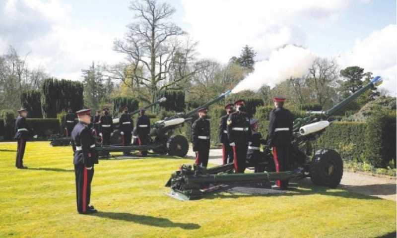Members of 105th Regiment Royal Artillery fire a 41-round gun salute to mark the passing of Prince Philip at Hillsborough Castle in Northern Ireland on Saturday.—AP