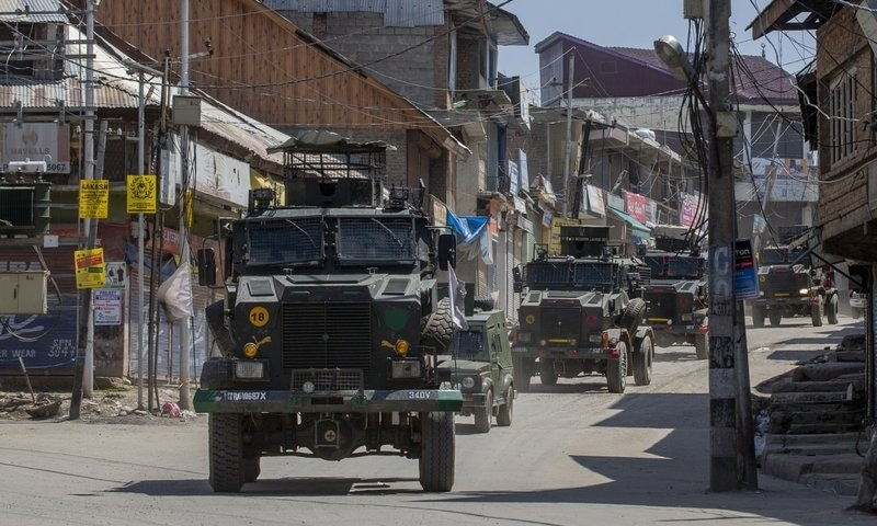 Indian army vehicles leave after the site of a gunbattle in Shopian, south of Srinagar, Indian-occupied Kashmir, April 9. — AP