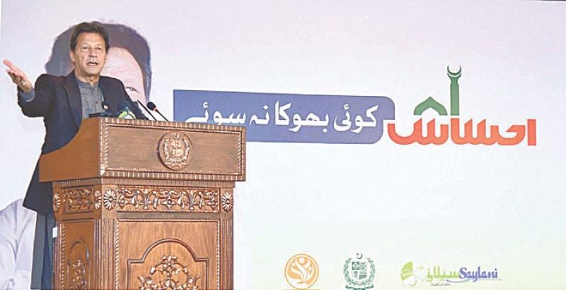 ISLAMABAD: Prime Minister Imran Khan speaks at the virtual launch of 'Koi Bhooka Na Soye' programme on Sunday.—APP