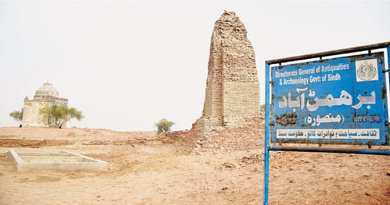 A NAVIGATION watch tower or stupa stands behind a signboard indicating ruins of the ancient site of Brahmanabad and Mansura in Sanghar.—Photo by Umair Ali