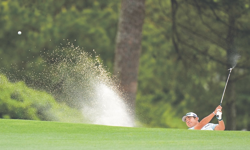 HIDEKI Matsuyama of Japan hits out of a bunker during the third round of the Masters.—AP
